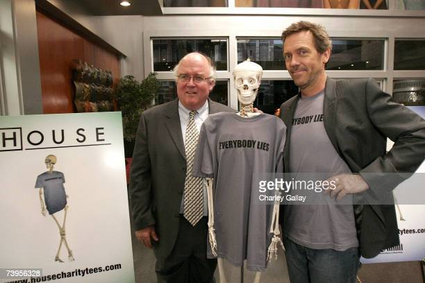 Executive Director of the National Alliance on Mental Illness Mike Fitzpatrick and actor Hugh Laurie pose at the announcement of the creation of...