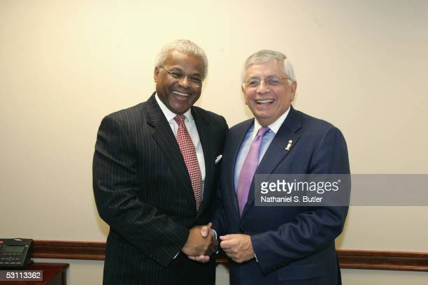 Executive Director of the NBA Players Association Billy Hunter and NBA Commissioner David Stern shake hands during a press conference to announce...