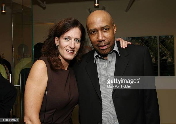 Executive Director of the New York Chapter Elizabeth Healy and Eulis Cathey the New York Chapter of NARAS Open House Reception at New York Chapter...