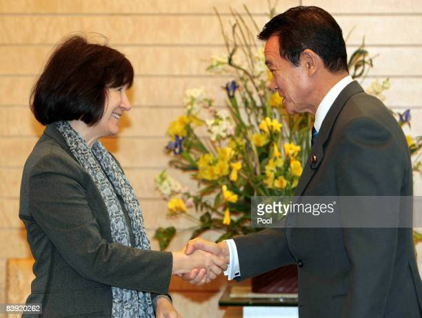 Executive Director of the United Nations Development Fund for Women Ines Alberdi is greeted by Japanese Prime Minister Taro Aso at the prime...