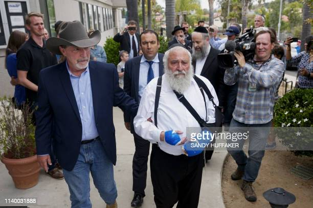 Executive Director Rabbi Yisroel Goldstein, who was shot in the hands, walks towards a press conference with Poway Mayor Steve Vaus outside of the...