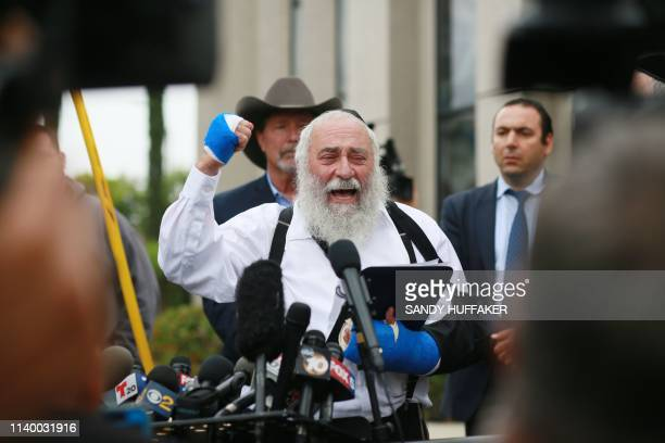 Executive Director Rabbi Yisroel Goldstein who was shot in the hands speaks to members of the media duringa press conference outside of the Chabad of...