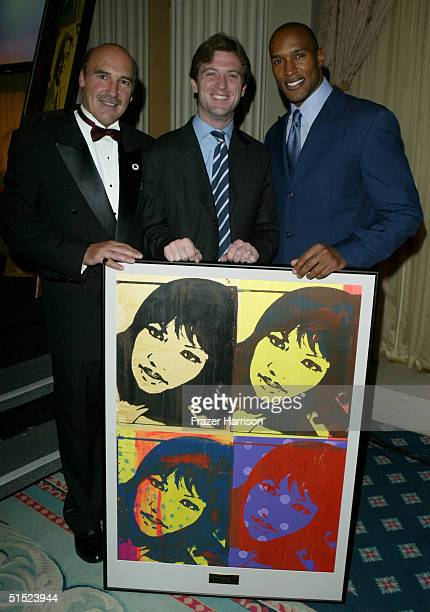 Executive Director Silvio John Orlando, Mike Nilon and actor Henry Simmons are seen offstage after accepting the 2004 Mentor Award on behalf of...