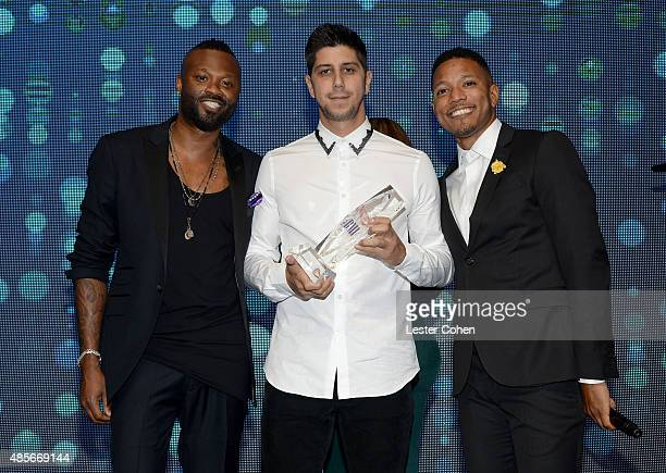BMI Executive Director Writer/Publisher Relations Los Angeles Wardell Malloy recording artist SoMo and BMI senior director Ian Holder pose with the...