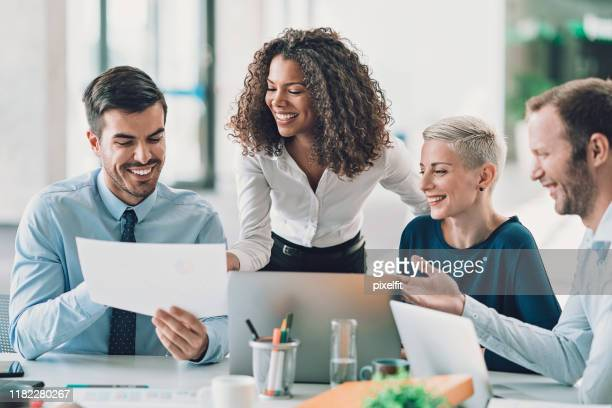 executive directors looking at financial reports - leadership stock pictures, royalty-free photos & images