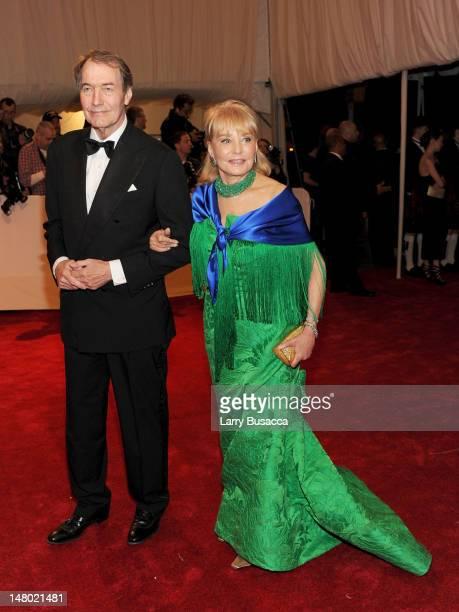 Executive editor/anchor Charlie Rose and Barbara Walters attend the Alexander McQueen Savage Beauty Costume Institute Gala at The Metropolitan Museum...