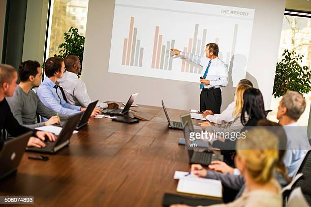 executive explaining graph - financial analyst stock photos and pictures