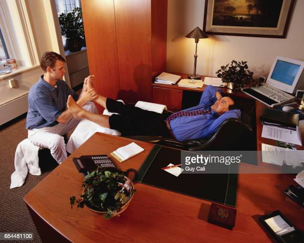 Executive Getting Foot Massage in His Office