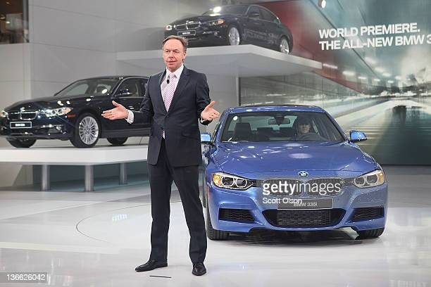 BMW executive Ian Robertson introduces the new BMW 3 Series during the press preview at the North American International Auto Show at the COBO Center...