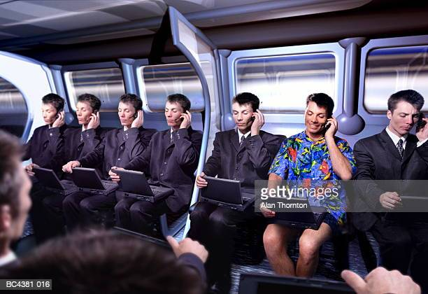 executive in hawaiian shirt amongst commuters (digital composite) - cloning stock pictures, royalty-free photos & images