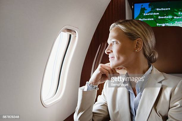 Executive looking out of window on airplane