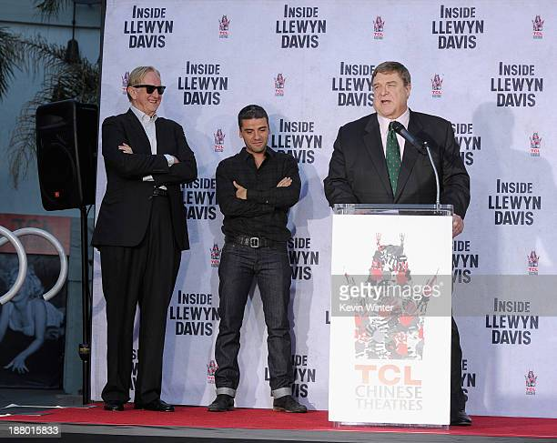Executive music producer T Bone Burnett actor Oscar Isaac and actor John Goodman attend the John Goodman Hand and Footprint Ceremony at TCL Chinese...