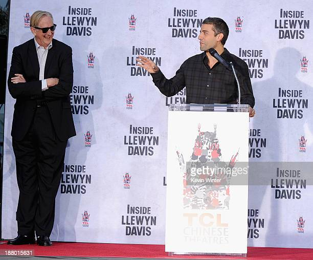 Executive music producer T Bone Burnett and actor Oscar Isaac attend the John Goodman Hand and Footprint Ceremony at TCL Chinese Theatre on November...