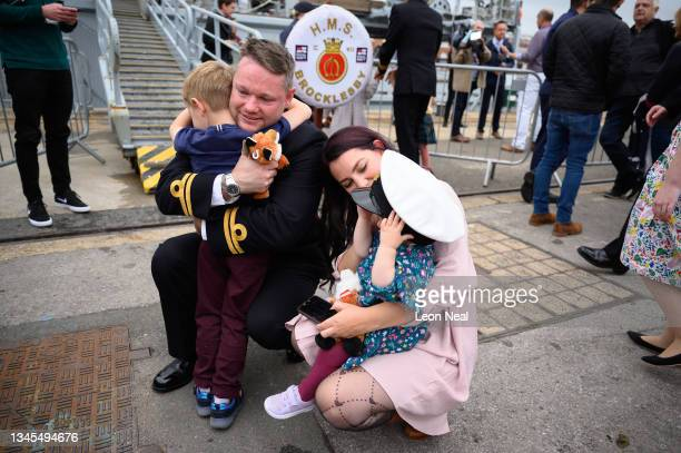 Executive Officer Josh Beale is greeted by his wife Jess, son Quinn and daughter Luna after disembarking HMS Brocklesby on October 08, 2021 in...