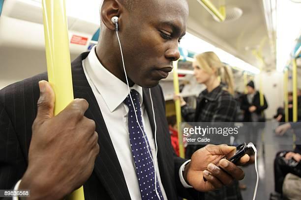 executive on the london underground - vertical red tube fotografías e imágenes de stock