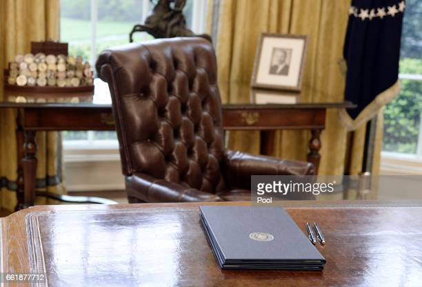 Executive Orders regarding trade lay on the Resolute desk in the Oval Office of the White House March 31, 2017 in Washington, DC. President Trump...