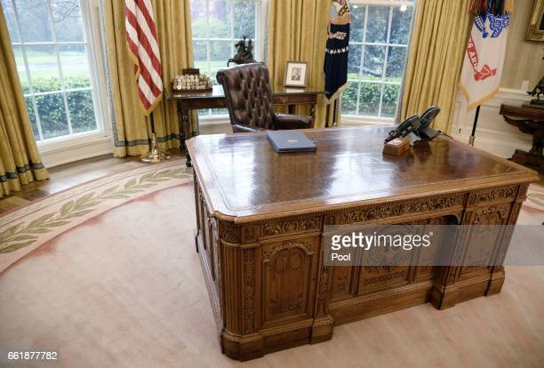 Executive Orders regarding trade lay on the Resolute desk in the Oval Office of the White House March 31 2017 in Washington DC President Trump signed...