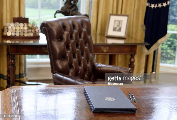 Executive orders regarding trade lay on the Resolute desk in the Oval Office of the White House in Washington, D.C., U.S., March 31, 2017. President...