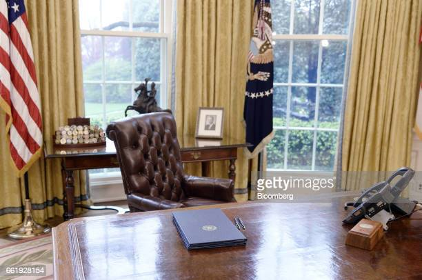 Executive orders regarding trade lay on the Resolute desk in the Oval Office of the White House in Washington DC US March 31 2017 President Donald...