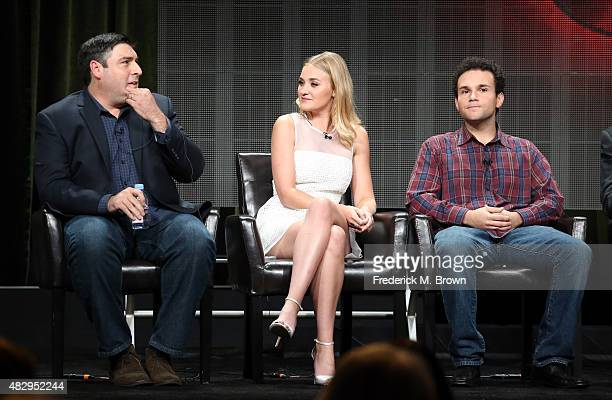 Executive producer Adam Goldberg and actors AJ Michalka and Troy Gentile speak onstage during the 'The Goldbergs' panel discussion at the ABC...
