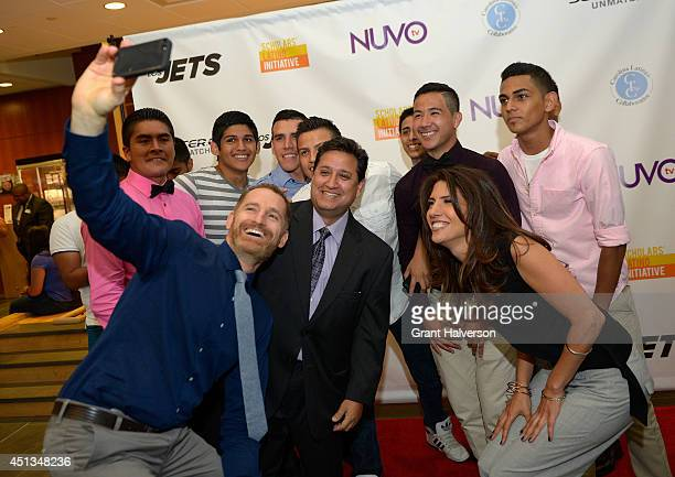 Executive producer and director Mark Landsman coach Paul Cuadros and executive director Lynda Lopez pose for a selfie with the JordanMatthews High...