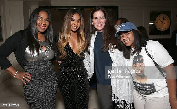Executive producer Ashanti poses with her mother Tina Douglas Producer Amy Williams and sister Kenashia Douglas at the after party for Screen Media...