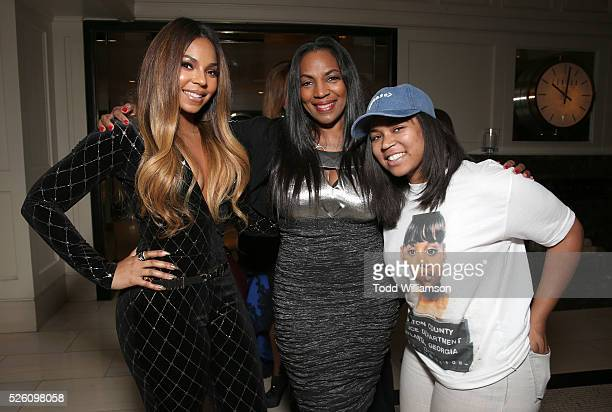 Executive producer Ashanti poses with her mother Tina Douglas and sister Kenashia Douglas at the after party for Screen Media Film's 'Mothers And...