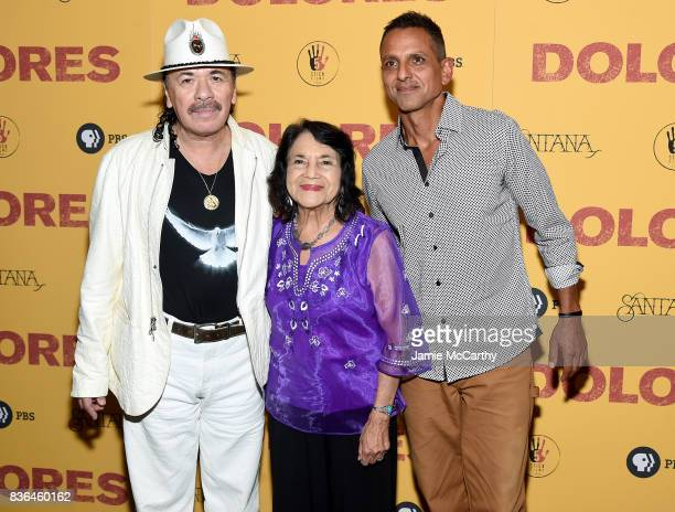 Executive Producer Carlos Santana activist Dolores Huerta and director Brian Bratt attend the 'Dolores' New York Premiere at The Metrograph on August...