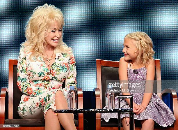 Executive producer Dolly Parton and actress Alyvia Alyn Lind speak onstage during NBC's 'Dolly Parton's Coat of Many Colors' panel discussion at the...