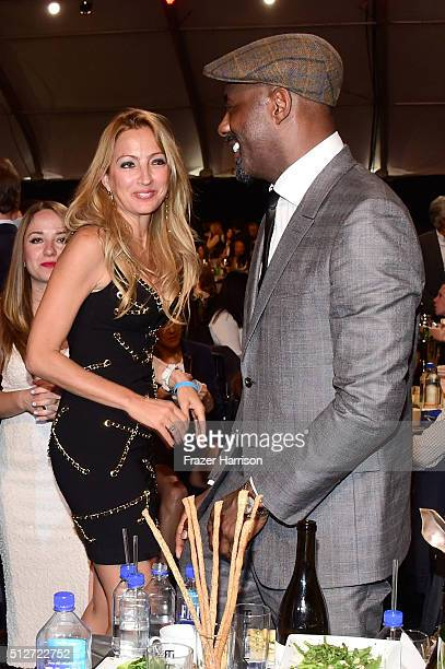 Executive producer Elika Portnoy and actor Idris Elba attend the 2016 Film Independent Spirit Awards on February 27 2016 in Santa Monica California