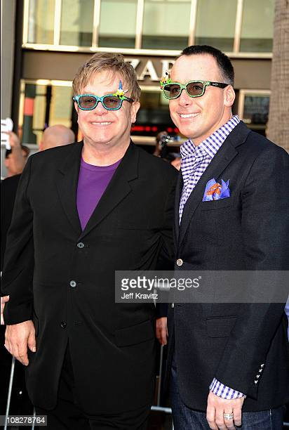 Executive producer Elton John and his partner David Furnish arrive at the Los Angeles premiere of 'Gnomeo and Juliet' at the El Capitan Theatre on...