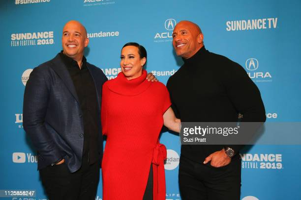 Executive producer Hiram Garcia producer Dany Garcia and actor and producer Dwayne Johnson pose for a photo at the Sundance special screening of...
