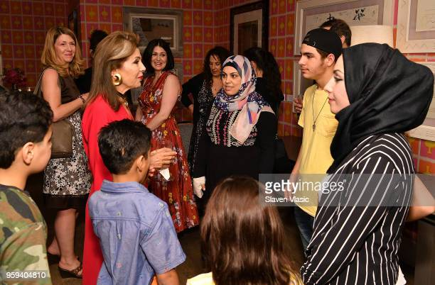 Executive producer HRH Princess Firyal of Jordan greets the Alhalabi family during 'This is Home A Refugee Story' New York Premier Screening at...