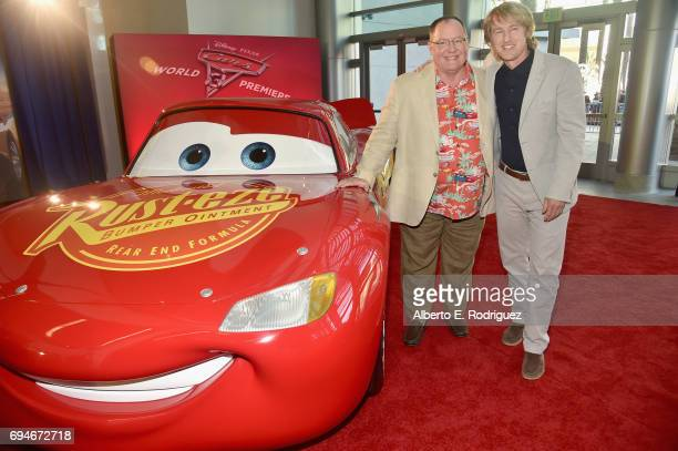 """Executive producer John Lasseter and actor Owen Wilson pose at the World Premiere of Disney/Pixar's """"Cars 3' at the Anaheim Convention Center on June..."""