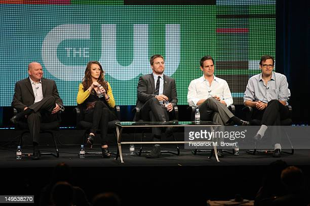 Executive producer Marc Guggenheim actors Katie Cassidy Stephen Amell executive producers Greg Berlanti and Andrew Kreisberg speak at the 'Arrow'...