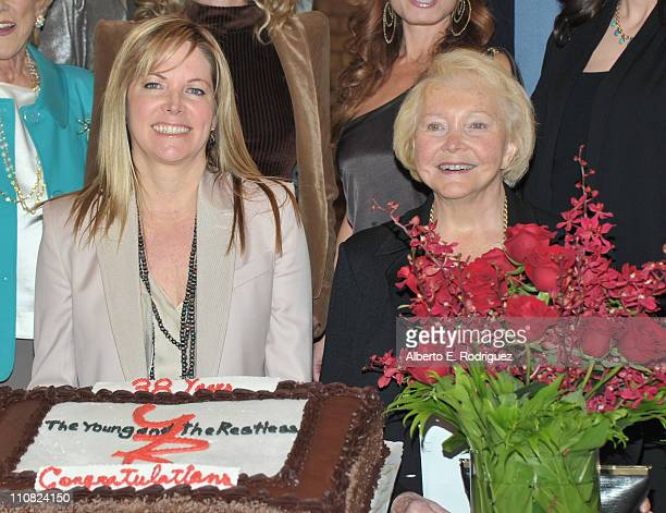 Executive producer Maria Arena Bell and creator Lee Phillip Bell attend CBS' The Young and the Restless 38th Anniversary cake cutting on March 24...
