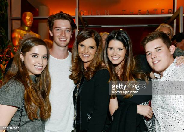 Executive producer Maria Shriver is flanked by her children from left Christina Schwarzenegger Patrick Schwarzenegger Katherine Schwarzenegger and...