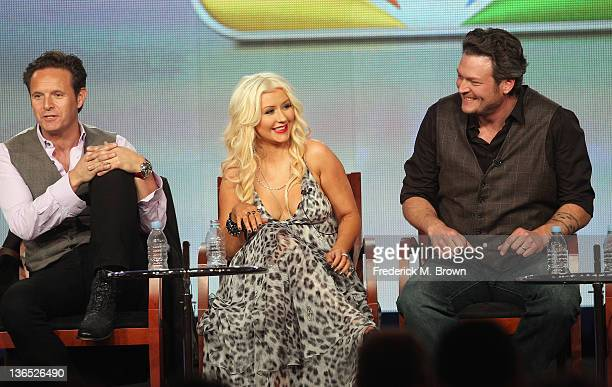Executive Producer Mark Burnett Coach Christina Aguilera and Coach Blake Shelton speak onstage during the The Voice panel during the NBCUniversal...