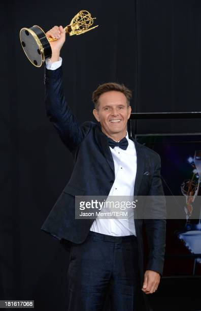 Executive Producer Mark Burnett winner of the Outstanding Reality Competition Program Award for The Voice poses in the press room during the 65th...