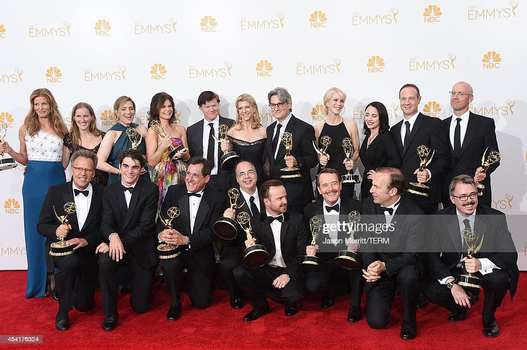 Executive producer Mark Johnson, Co-Executive Producer Melissa Bernstein, Producer Karen Moore, actors Betsy Brandt, Jesse Plemons, Executive Producer Michelle MacLaren, Co-Executive Producer Peter Gould, writer Moira Walley-Beckett, actress Laura Fraser, Co-Executive Producer George Mastras, Co-Producer Sam Catlin, (L-R Bottom) actor RJ Mitte, Producer Stewart Lyons, Co-Executive Producer Thomas Schnauz, Show Creator Vince Gilligan and actor Bob Odenkirk, winners of Outstanding Drama Series Award, Outstanding Lead Actor in a Drama Series Award, Outstanding Supporting Actor in a Drama Series Award, Outstanding Supporting Actress in a Drama Series and Outstanding Writing for a Drama Series for 'Breaking Bad', pose in the press room during the 66th Annual Primetime Emmy Awards held at Nokia Theatre L.A. Live on August 25, 2014 in Los Angeles, California.