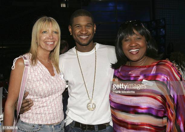 Executive Producer Melissa Corken singer Usher and his mother and Manager Jonnetta Patton during rehearsals for the 2004 World Music Awards September...