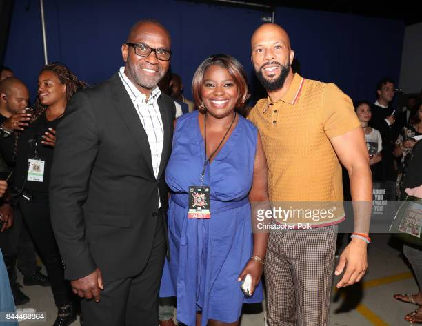 Executive Producer of EIF Presents XQ Super School Live Julius Tennon Deloris Grant and Common pose during the XQ Super School Live presented by EIF...