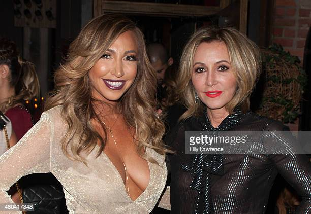 Executive producer of Hollyscoop Diana Madison and Anastasia Soare attend Shandy Media Holiday Party on December 12 2014 in Hollywood California