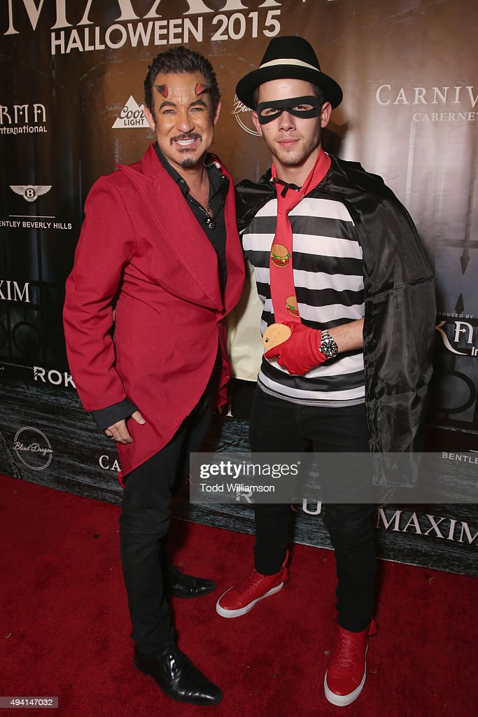 CEO & Executive Producer of Karma International Dylan Marer (L) and recording artist Nick Jonas attend the Maxim Halloween Party Presented By Karma International on October 24, 2015 in Los Angeles, California.