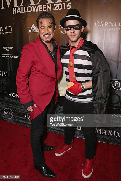 CEO Executive Producer of Karma International Dylan Marer and recording artist Nick Jonas attend the Maxim Halloween Party Presented By Karma...