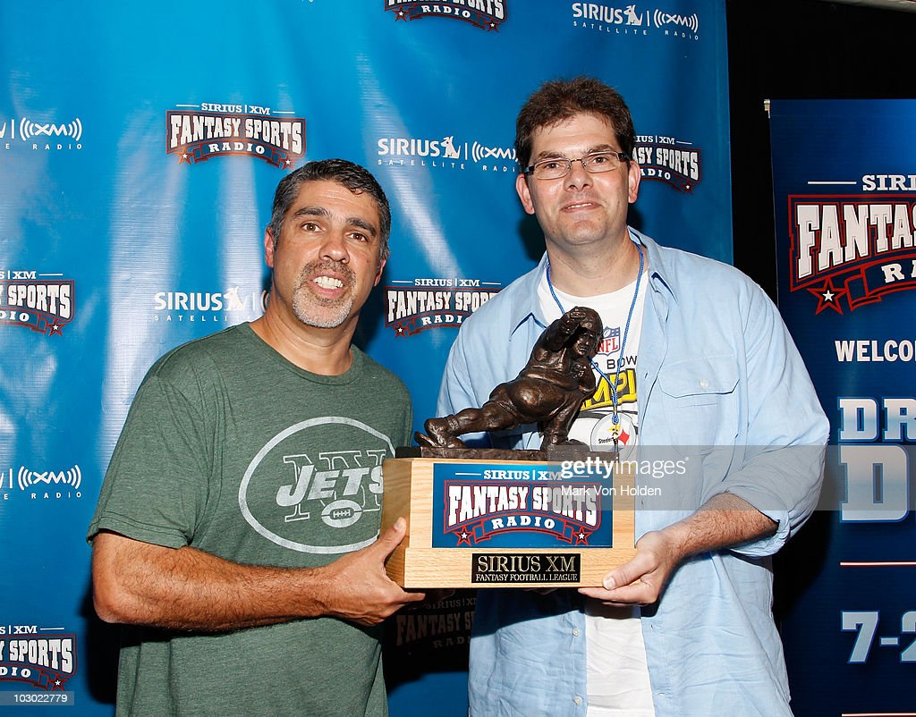 Executive producer of the Howard Stern Show Gary Dell'Abate and Cohost of the Howard Stern wrap up show, Jon Hein attend the SIRIUS XM Radio celebrity fantasy football draft at Hard Rock Cafe - Times Square on July 21, 2010 in New York City.