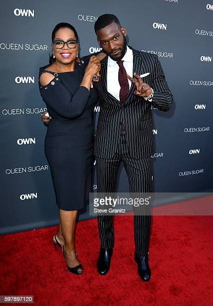 "Executive producer Oprah Winfrey and actor Kofi Siriboe attend OWN Oprah Winfrey Network's ""Queen Sugar"" premiere at the Warner Bros Studio Lot..."