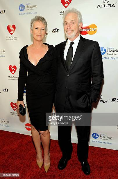 Executive Producer Pieter Jan Brugge and actress Jamie Lee Curtis arrive at 2011 MusiCares Person of the Year Tribute to Barbra Streisand at Los...