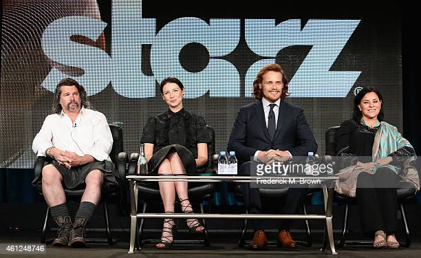 Executive Producer Ronald D Moore actors Caitriona Balfe Sam Heughan and author Diana Gabaldon speak onstage during the 'Outlander' panel at the...