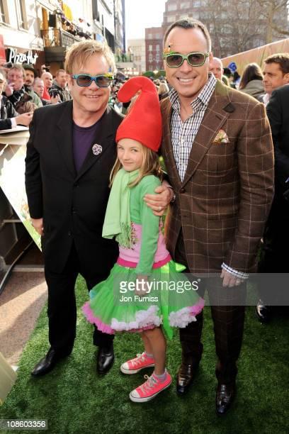 Executive producer Sir Elton John David Furnish's goddaughter Esmie Bertlesen and producer David Furnish attends the 'Gnomeo Juliet' premiere at...